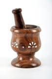 Ayurvedic prepration. Preparation the ayurvedic medicine in wooden grinder Stock Photos