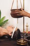 Ayurvedic shirodhara treatment in India Stock Photo
