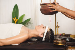 Ayurvedic shirodhara treatment in India stock image