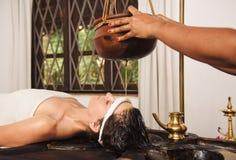 Ayurvedic shirodhara treatment in India Stock Photos
