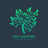 Ayurvedic spa design symbol, green vector tree. Green circle tree with leaves vector logo design template isoletad on dark background. Ayurvedic tree icon Stock Images