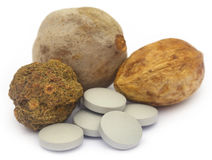 Ayurvedic Triphala with pills Stock Image