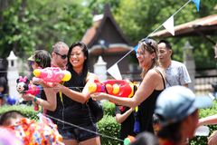 AYUTHAYA, THAILAND - APRIL 13:Girls play splashing with crowd in. Songkran Festival at Ayuthaya, Thailand as the traditional New Year`s Day on 13 April 2017 Royalty Free Stock Image