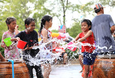 AYUTHAYA, THAILAND - APRIL 13:Girls play splashing with crowd in stock photo