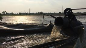 Pumping water to prepare the rice area stock footage