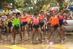 Group of dancer playfully and dancing splashing water on a street. AYUTTHAYA , THAILAND-APRIL13 , 2016 : Unidentified dancer is dancing fun and happiness in stock images