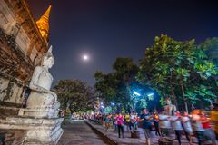 Buddhists people walking with lighted candles in hand around a ancient temple royalty free stock photos