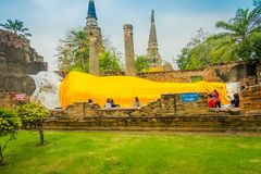AYUTTHAYA, THAILAND, FEBRUARY, 08, 2018: Outdoor view of unidentified people taking pictures of Reclining Buddha Royalty Free Stock Photography