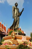 Ayutthaya, Thailand: Giant Standing Buddha. A giant bronze standing Buddha with uplifted arm is the imposing attraction at Wat Prayathikaran in Ayutthaya Royalty Free Stock Images