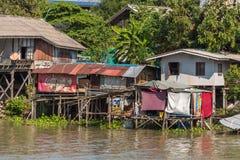 Slums of Ayutthaya town. Ayutthaya, Thailand - January 1, 2016: Slums along the river in Auyutthaya Royalty Free Stock Image