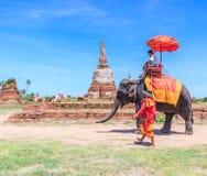AYUTTHAYA, THAILAND - JUNE 1: Tourists on an elephant Stock Photo