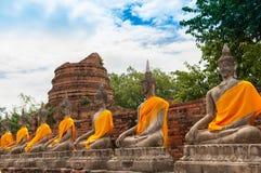 AYUTTHAYA,THAILAND-JUNE 27, 2013: Watyaichaimongkol. AYUTTHAYA,THAILAND-JUNE 27, 2013: Aligned statues of Buddha in Watyaichaimongkol Royalty Free Stock Photos