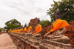 AYUTTHAYA,THAILAND-JUNE 27, 2013: Watyaichaimongkol. AYUTTHAYA,THAILAND-JUNE 27, 2013: Aligned statues of Buddha in Watyaichaimongkol Royalty Free Stock Photo