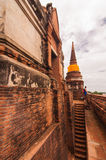 AYUTTHAYA,THAILAND-JUNE 27, 2013: Watyaichaimongkol. AYUTTHAYA,THAILAND-JUNE 2013: Walking around Watyaichaimongkol,tourist always look down to see city plan of Royalty Free Stock Photography