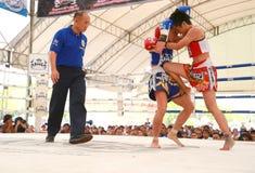 Women Thai boxing match. AYUTTHAYA, THAILAND- MARCH 17 : Women Thai boxing match between  Yordying SithMuaySiam (Thai) VS Little Tiger (Japan) at World Muay Thai Royalty Free Stock Images