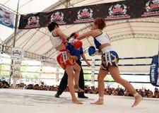Women Thai boxing match. AYUTTHAYA, THAILAND- MARCH 17 : Women Thai boxing match between  Yordying SithMuaySiam (Thai) VS Little Tiger (Japan) at World Muay Thai Stock Photos