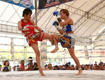Women Thai boxing match Stock Photo