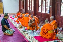 Novice and monks in merit making Royalty Free Stock Photo