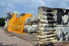 Ayutthaya, Thailand: Reclining Buddha. The imposing reclining Buddha with its giant feet, all that remains of Wat Lokaya Sutha in Ayutthaya, Thailand, is notable Stock Photo