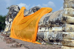 Ayutthaya, Thailand: Reclining Buddha. The imposing reclining Buddha with its giant feet, all that remains of Wat Lokaya Sutha in Ayutthaya, Thailand, is notable Royalty Free Stock Image