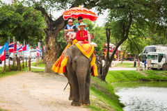Ayutthaya Thailand -  Tourists on an elephant ride tour of the a Stock Image