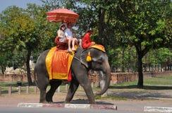 Ayutthaya, Thailand:  Visitors Riding an Elephant Royalty Free Stock Photos
