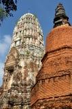 Ayutthaya, Thailand: Wat Ratcha Burana. An immense brick, bell-shaped Chedi (right) and the imposing cone-shaped central Prang at 15th century Wat Ratcha Burana Royalty Free Stock Photography