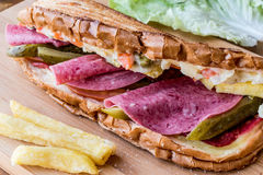 Ayvalik Toast / Salami Sandwich with Russian Salad, pickle and potatoes Royalty Free Stock Images