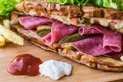 Ayvalik Toast / Salami Sandwich with Russian Salad, pickle and potatoes Stock Photography