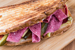 Ayvalik Toast / Salami Sandwich with Russian Salad and pickle Royalty Free Stock Photos