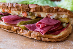 Ayvalik Toast / Salami Sandwich with Russian Salad and pickle Royalty Free Stock Image