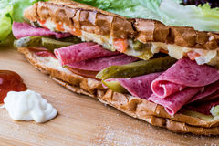 Ayvalik Toast / Salami Sandwich with Russian Salad and pickle Royalty Free Stock Images