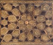 Ayyubid style panel with joined and carved wooden decorations of geometric and floral patterns. Mausoleum of Imam al-Shafi, Cairo, Egypt Royalty Free Stock Photos