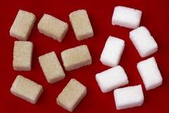 Azúcar blanco y marrón fotos de archivo