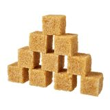 Azúcar de Brown, algunos pedazos. Foto de archivo