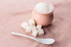 Azúcar en fondo rosado Fotos de archivo
