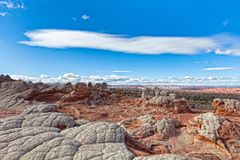 AZ-Paria Plateau-White Pocket. This image exhibits a panorama of the swirling patterens of rock formations of the White Pocket Royalty Free Stock Photography