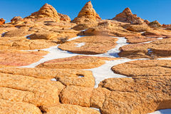AZ-UT-S. Coyote Buttes-Cottonwood Cove. As one hikes through these fantastic rock formations, seen are orange-colored boulders, and cone-like mini-hills Royalty Free Stock Images