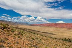 AZ-Vermillion Cliffs. The Vermillion Cliffs are a spectacular sight when heading down in elevation from the North Rim of the Grand Canyon towards House Rock Royalty Free Stock Images