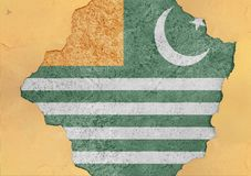 Azad Kashmire free state flag broken material facade structure. In big concrete cracked hole stock images