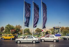 Azadi Square in Tehran. Tehran, Iran - October 15, 2016: Cars on Azadi Avenue next to Azadi Square in Tehran stock images