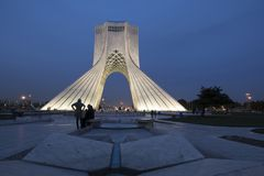 Azadi Tower at night formerly known as the Shahyad Tower is a m. TEHRAN, IRAN - 7 May 2018 Azadi Tower at dusk time formerly known as the Shahyad Tower is a royalty free stock image