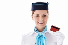 Azafata con un de la tarjeta de crédito Foto de archivo