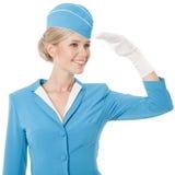 Azafata encantadora In Blue Uniform en el fondo blanco Fotografía de archivo