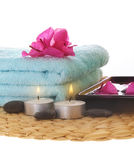 Azalea,candle and blue towel on mat Royalty Free Stock Images