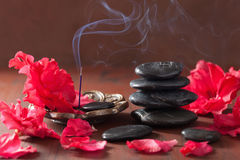 Azalea flowers black massage stones incense sticks for aromather Stock Photo