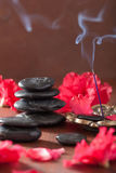 Azalea flowers black massage stones incense sticks for aromather Royalty Free Stock Photography
