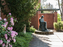 Azaleas bloom in front of Mestrovic statue on Oregon State Unive Royalty Free Stock Photography