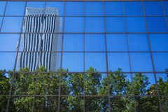 Azca reflection in building Stock Image