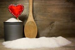 Azúcar y amor rojo del corazón Fotografía de archivo libre de regalías